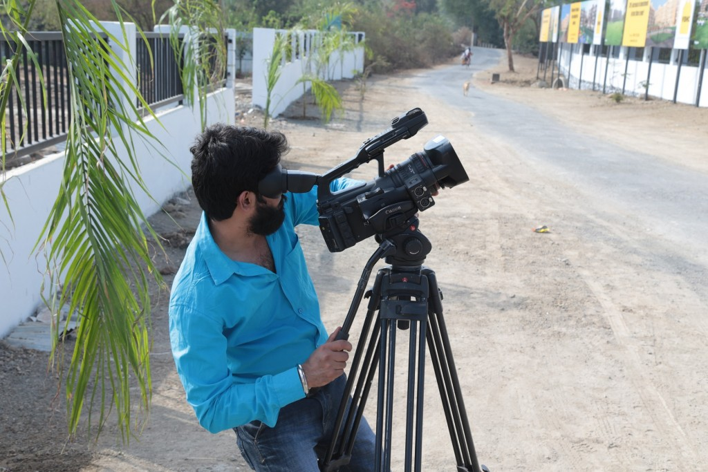 A man shooting video.